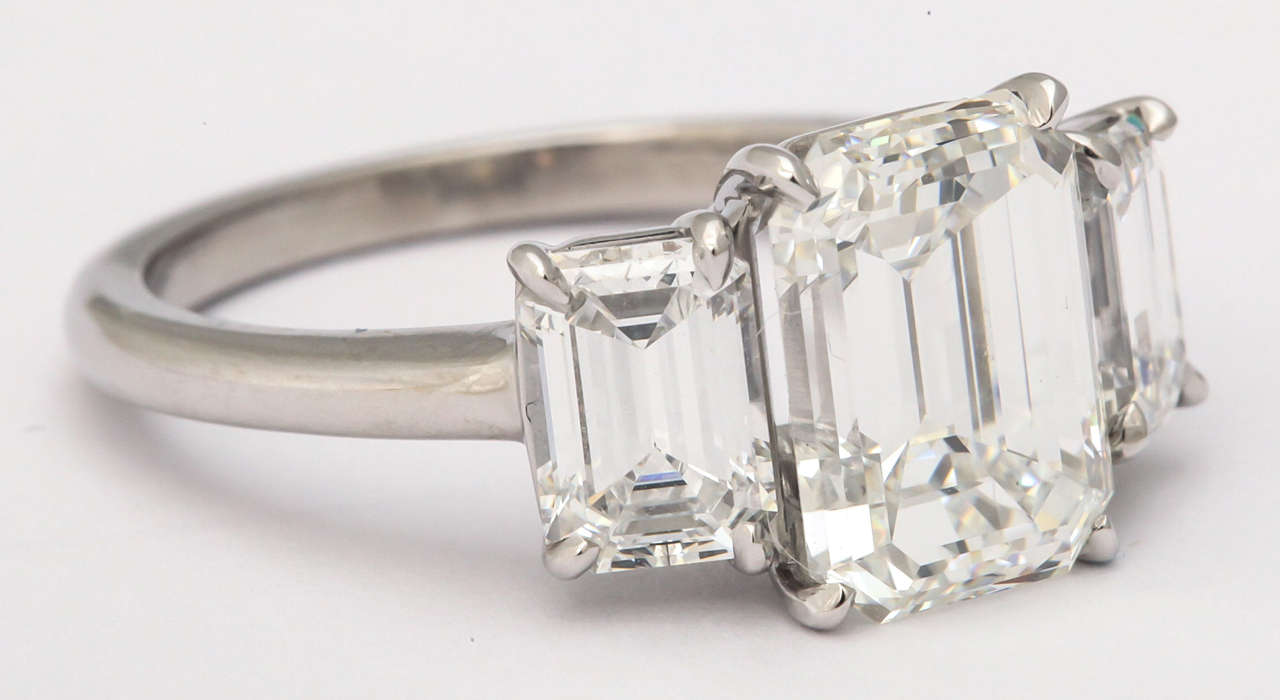 Magnificent Three Stone Emerald Cut Diamond Ring at 1stdibs