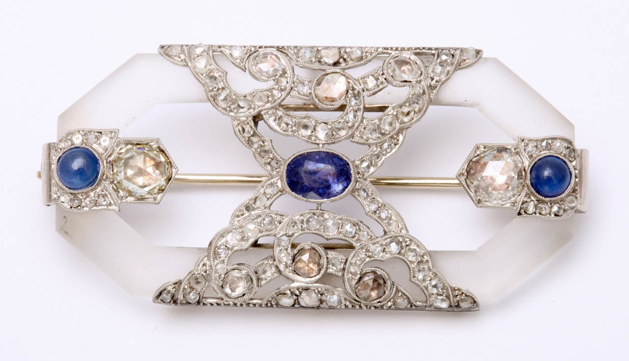 """2 cabochon Sapphires approximately 0.50 carat each 2 """"Twenteith Century"""" rose cut diamonds approximate weight 0.75 each 6 rose cut diamonds  0.50 carat total weight 66 small rose cut diamonds approximate weight 1.00 carat Center oval"""