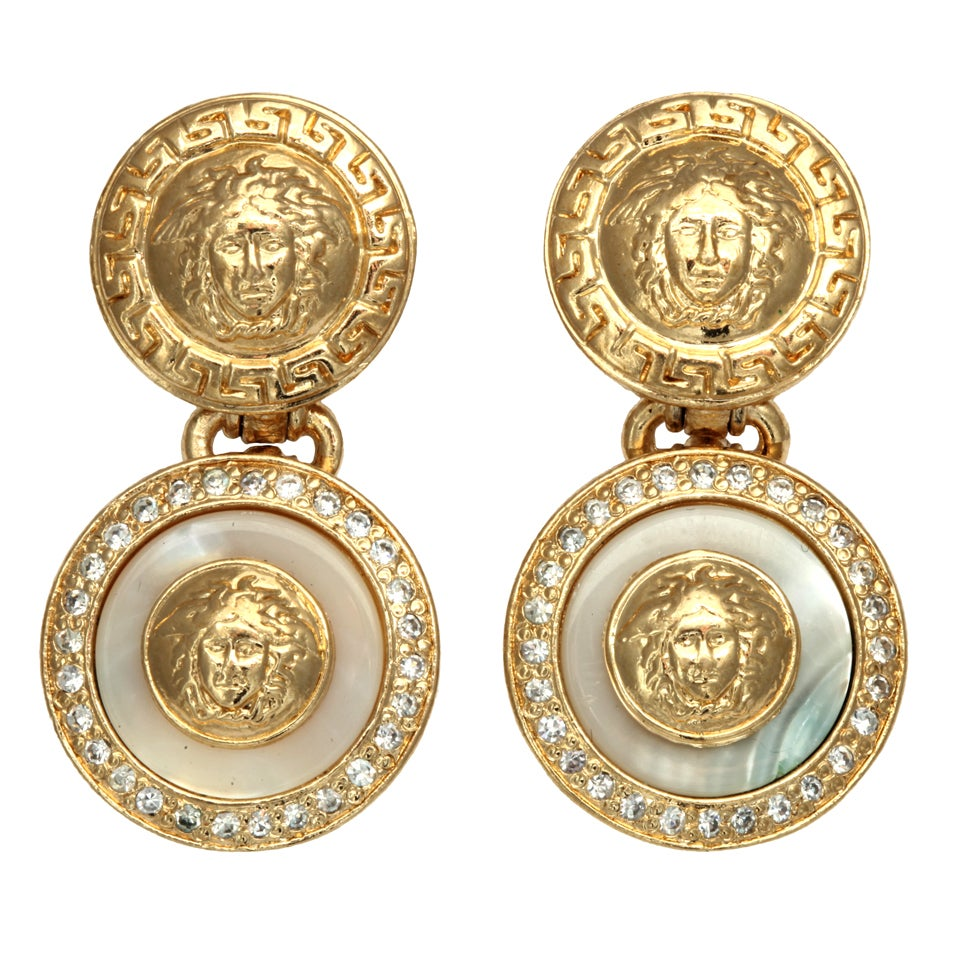 Gianni Versace white and gold dangling earrings with Medusa motifs For Sale