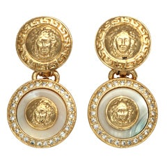 Gianni Versace white and gold dangling earrings with Medusa motifs