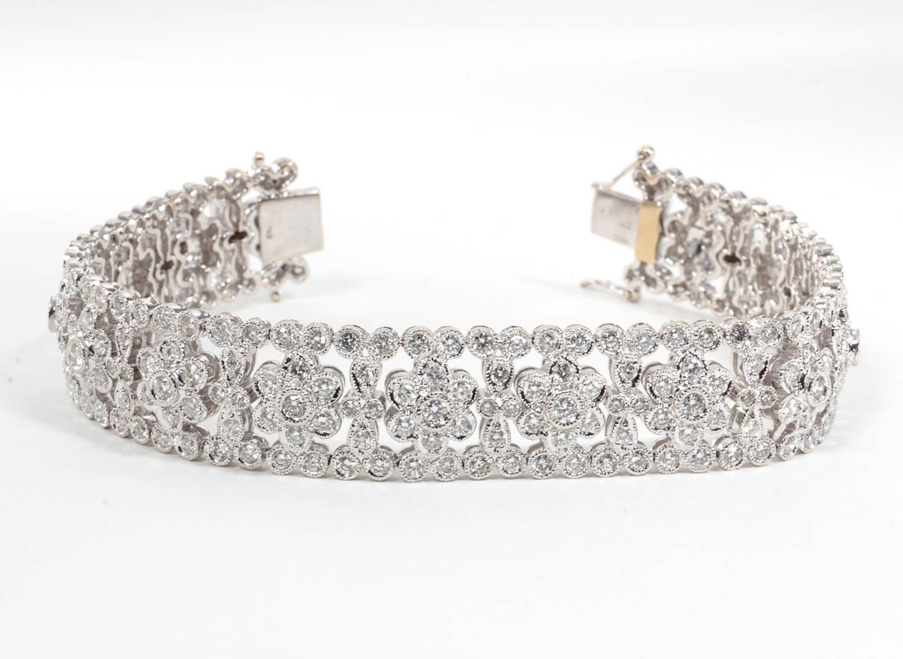 8.66 carats of vibrant round brilliant diamonds set in 18k white gold.  A stunning bracelet with a classic vintage feel.