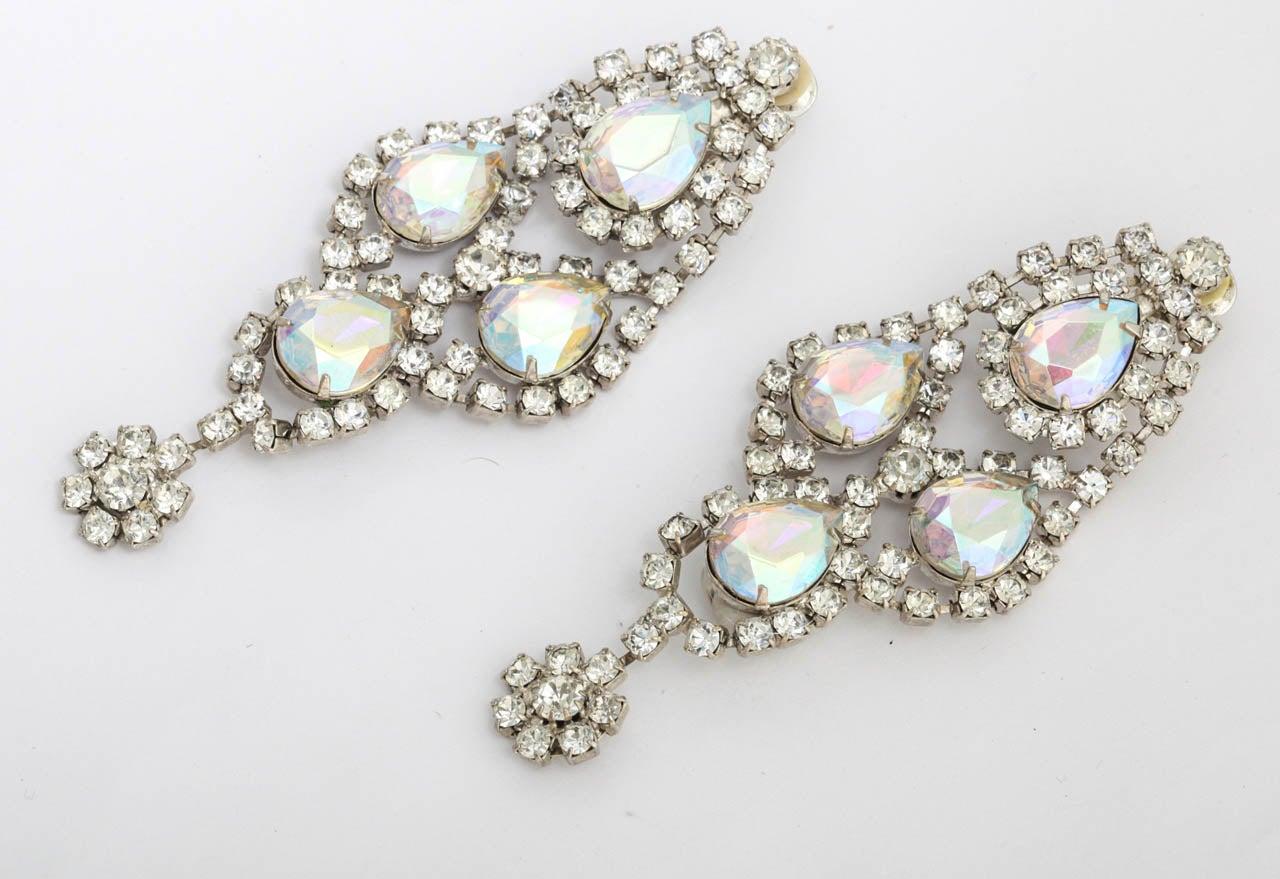 Prong set rhinestones in large drop earrings.