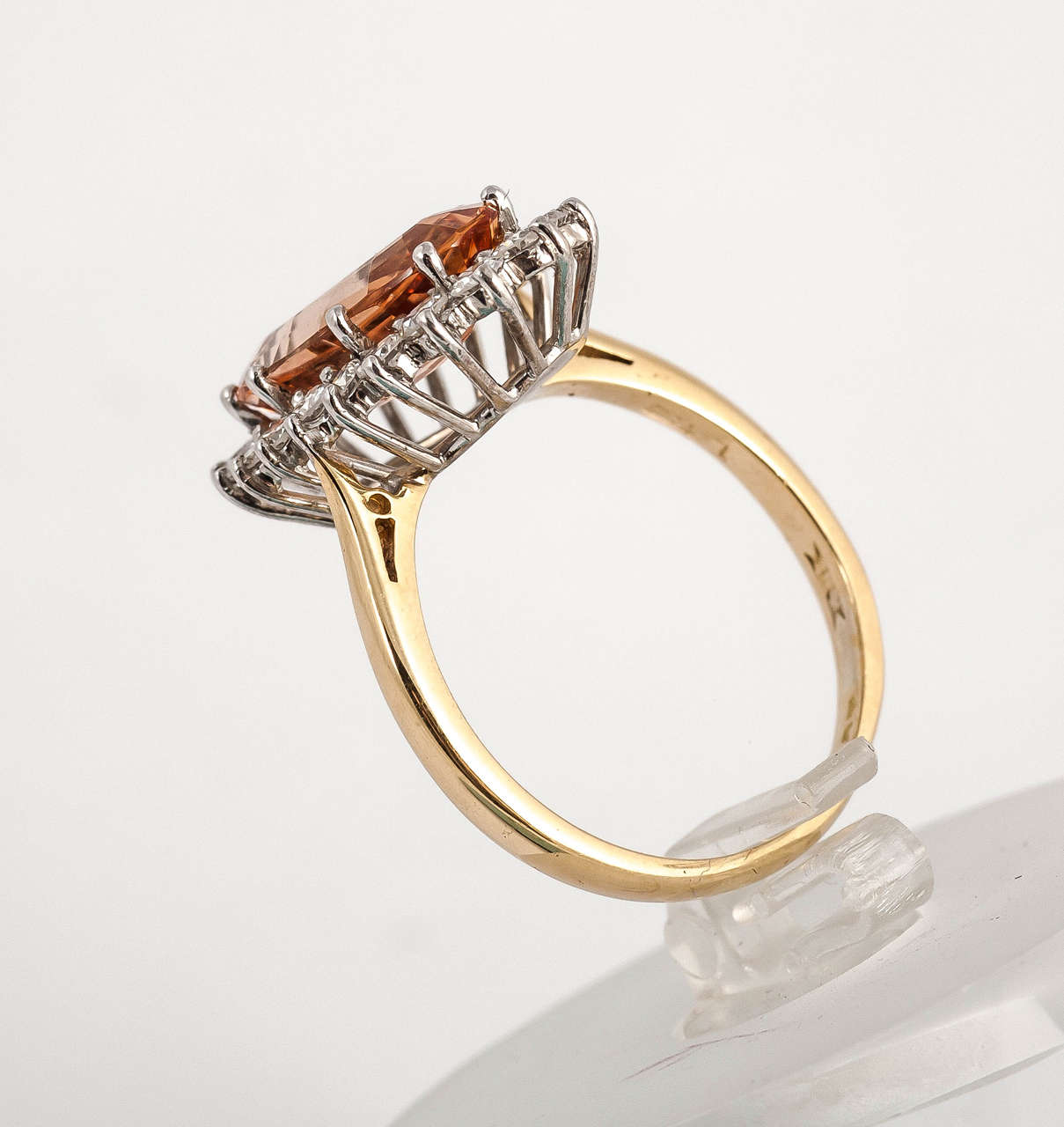 Fine colour Imperial topaz ring surrounded by diamonds set in 18ct Gold Finger size N 1/4
