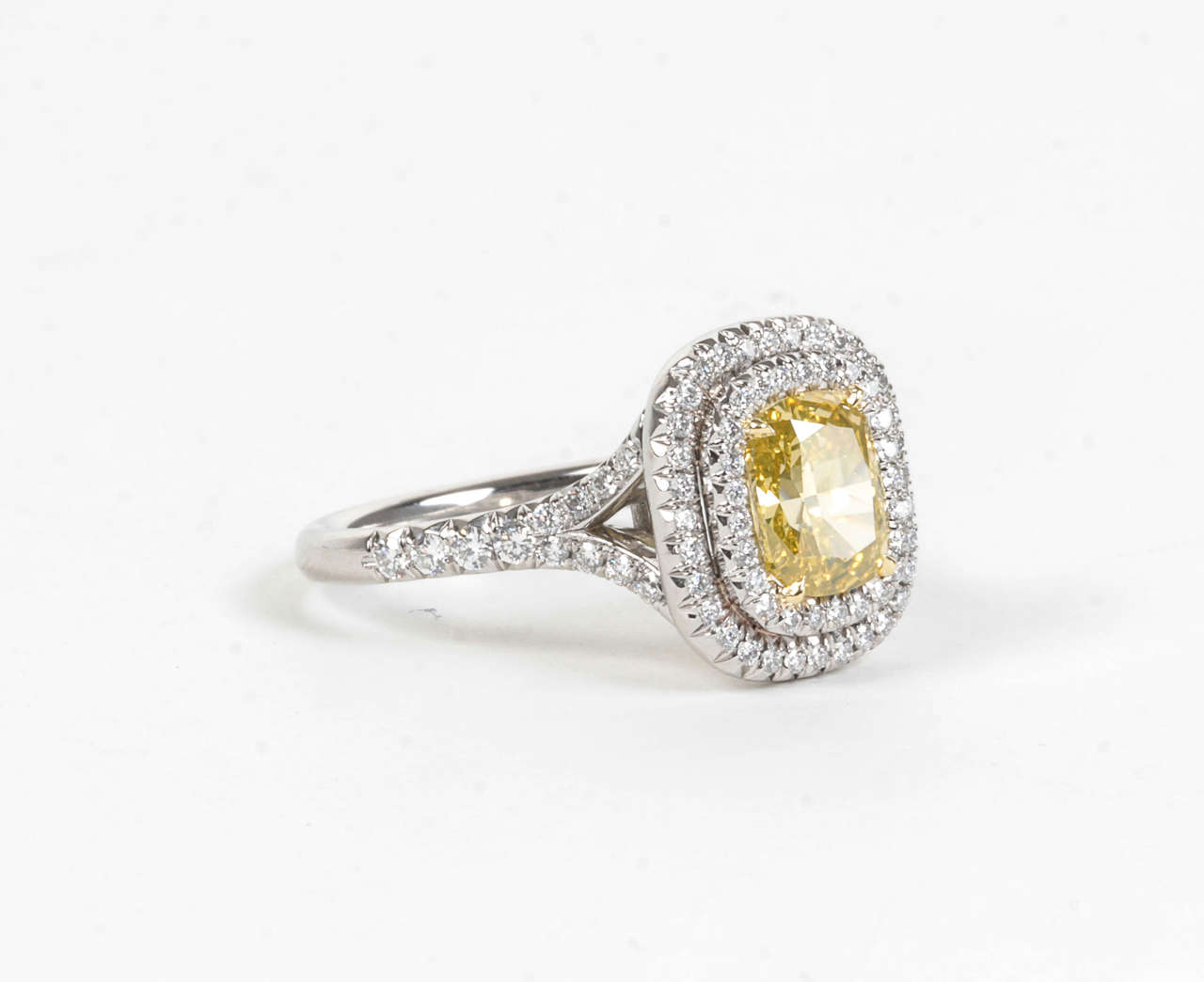 Women's Rare Cushion Cut GIA Certified Vivid Yellow and White Diamond Platinum Ring For Sale