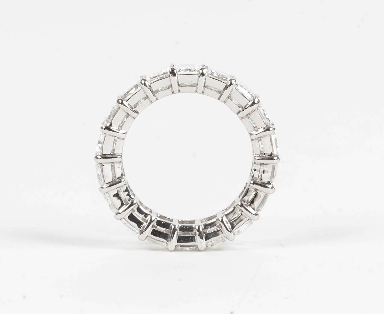 9 Carat Emerald Cut Diamond Platinum Eternity Band In As New Condition For Sale In New York, NY
