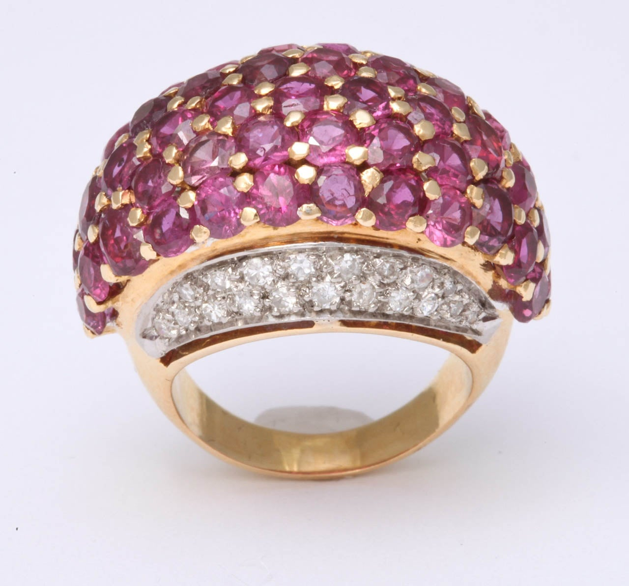 18Kt Yellow Gold Dome Ring.  Center set with faceted Rubies, prong set with sides , pave set, with full cut Diamonds. Approximately 2 cts of Diamonds & 5cts of Rubies.  Very chic & high style. Set in Rose Gold & Platinum.  The perfect Pinky Ring.