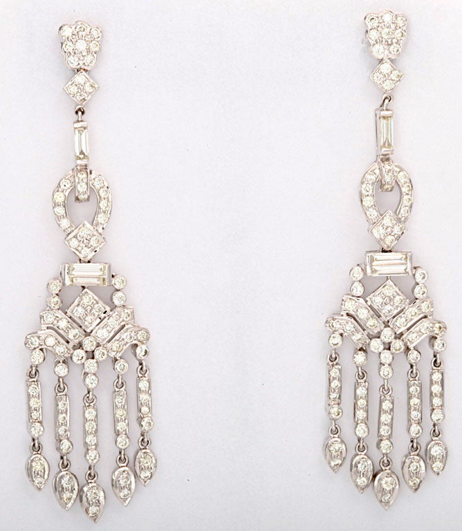 These delightful gems dance on the ear.  The earrings have 5.26 carats of diamonds set in 18k white gold.