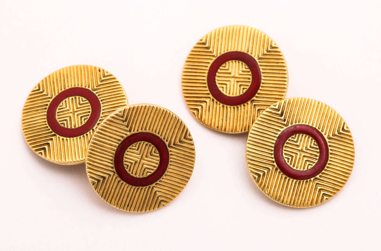 Circular with circular band of red enamel.   French Hallmark for 18kt gold/ maker's mark indistinct (2nd letter is D)