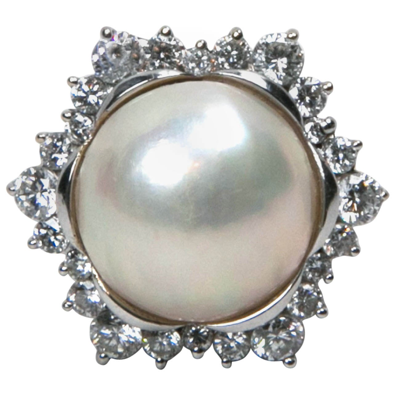 15mm mobe pearl ring with surrounded diamonds set in white