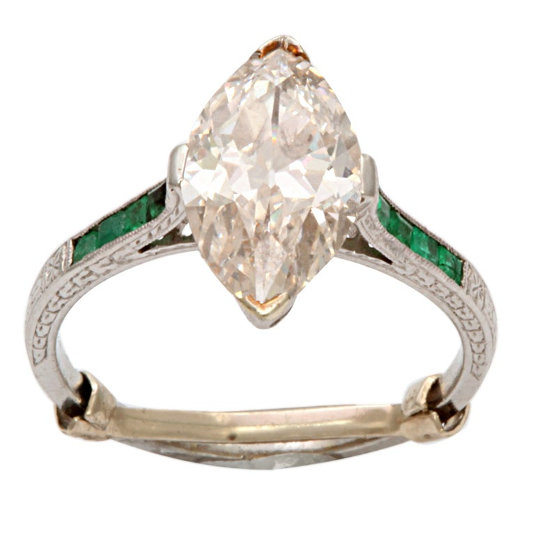 deco marquise emerald engagement ring at