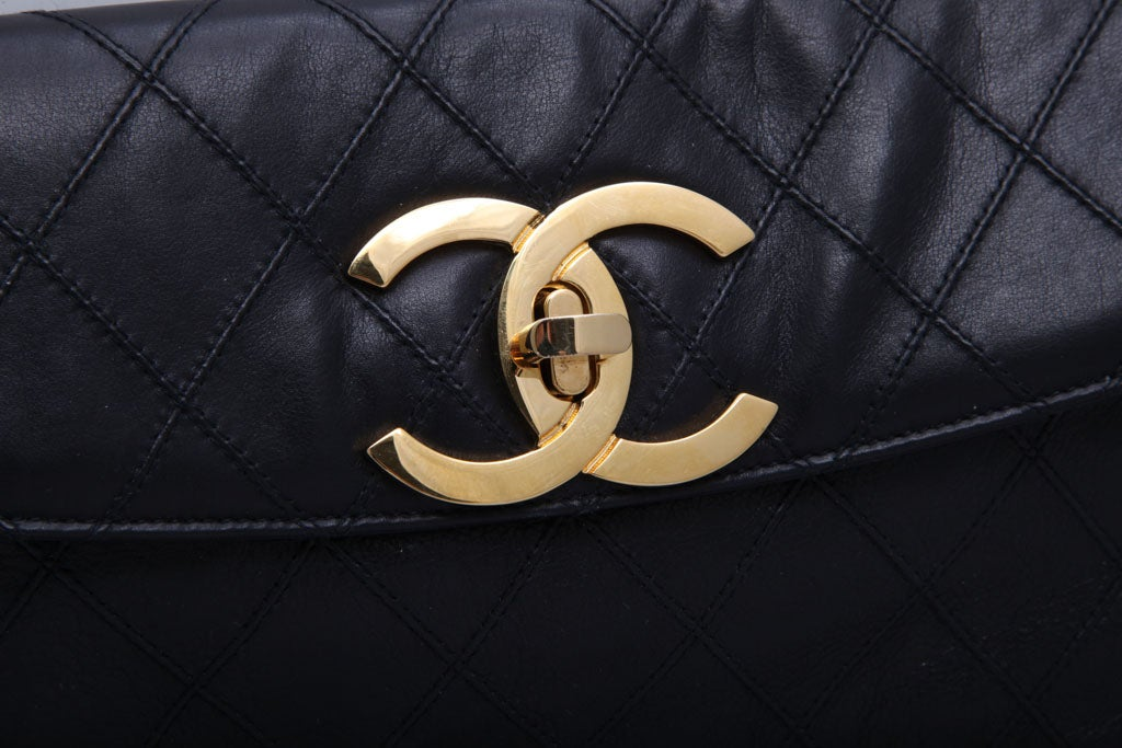 CHANEL QUILTED CLUTCH BAG 5