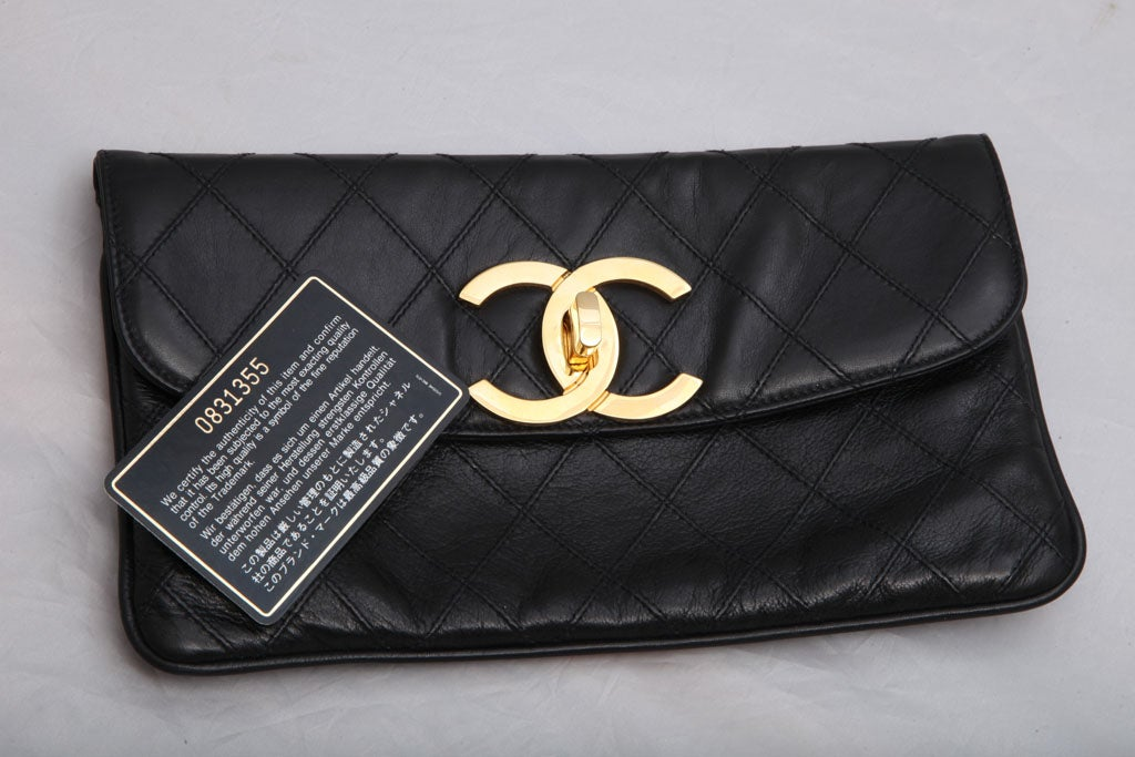CHANEL QUILTED CLUTCH BAG 7