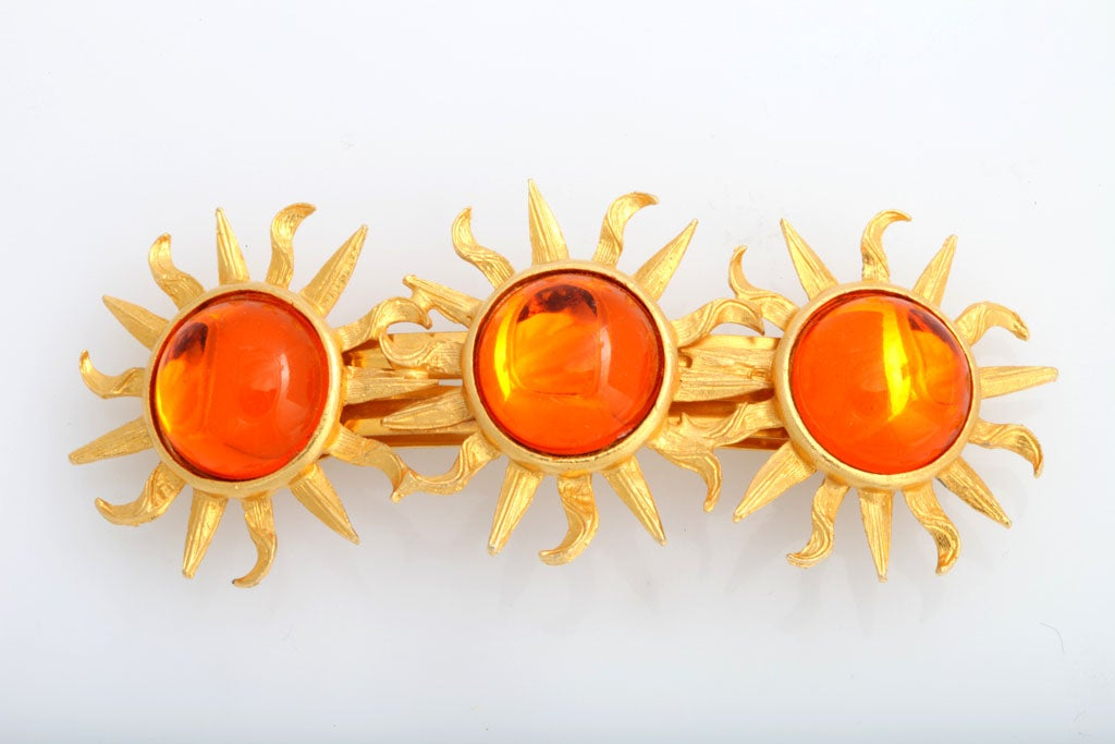 Large, stunning hair clip decorated with three orange cabochon suns.