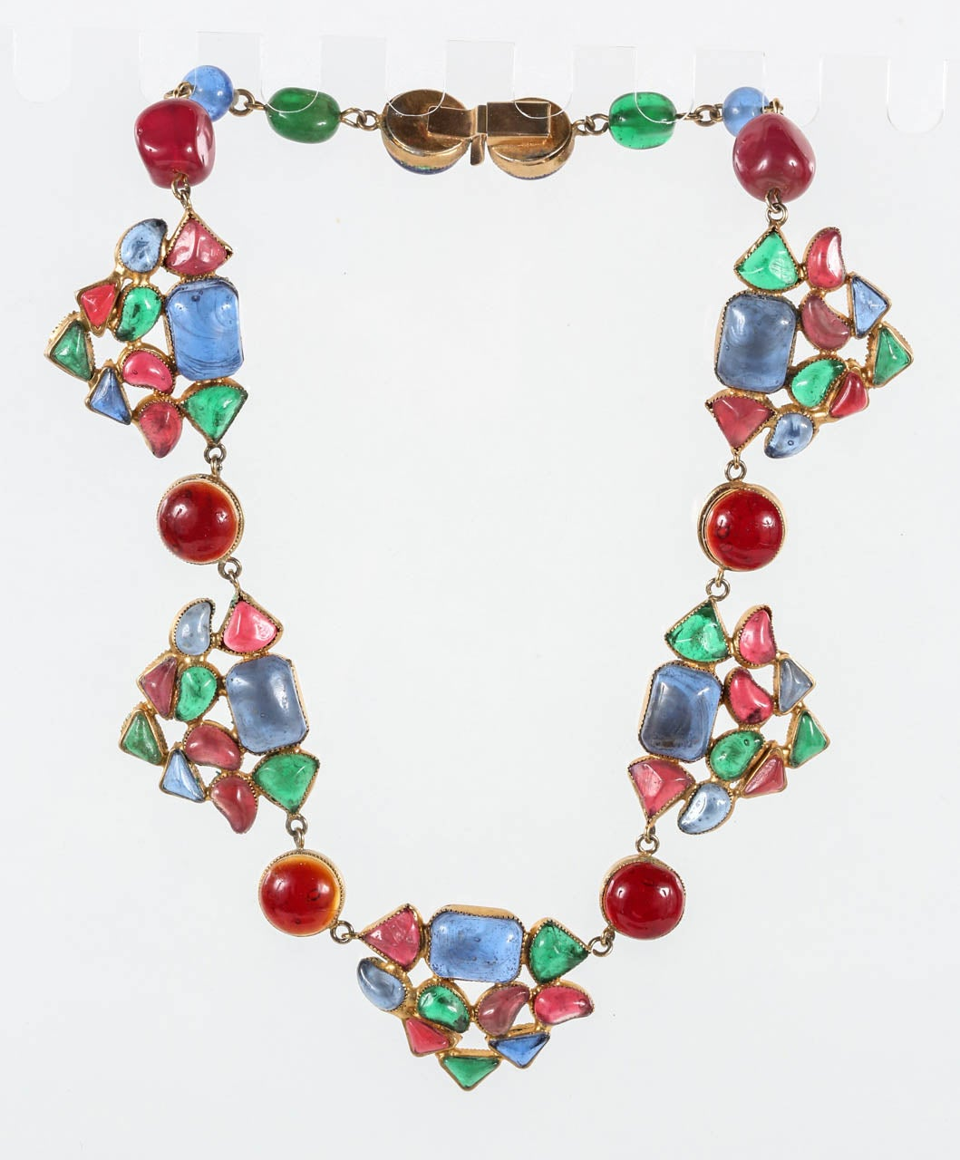 A beautiful and colorful Gripoix necklace in pink, red, green & blue. Although unmarked, based on the quality of this piece, it is undoubtedly by Chanel.