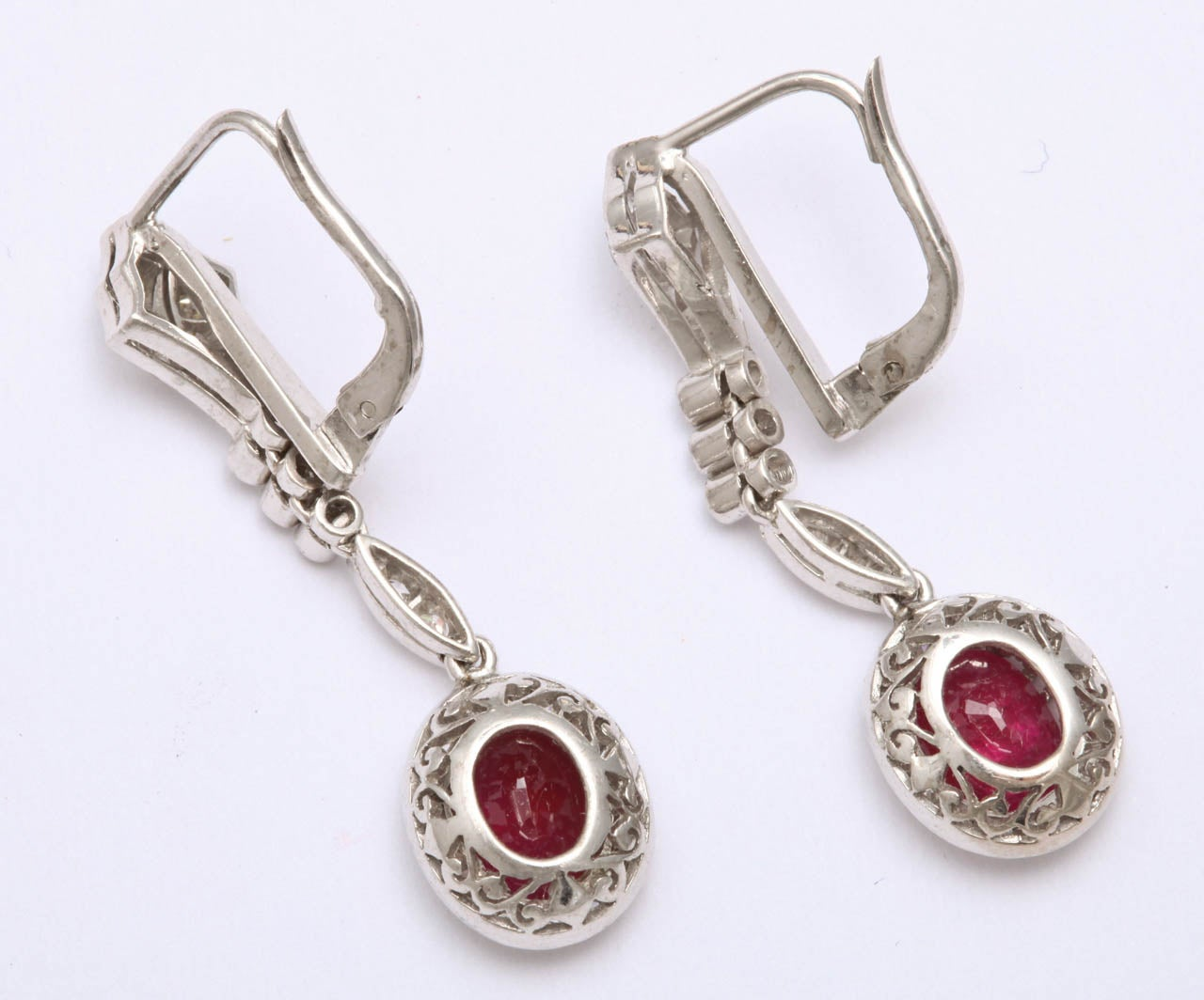 18kt  crown  setting ruby drop earrings, embellished with numerous old mine cut diamonds weighing approximately 1.50 carats and ruby weighing .50 carat each.