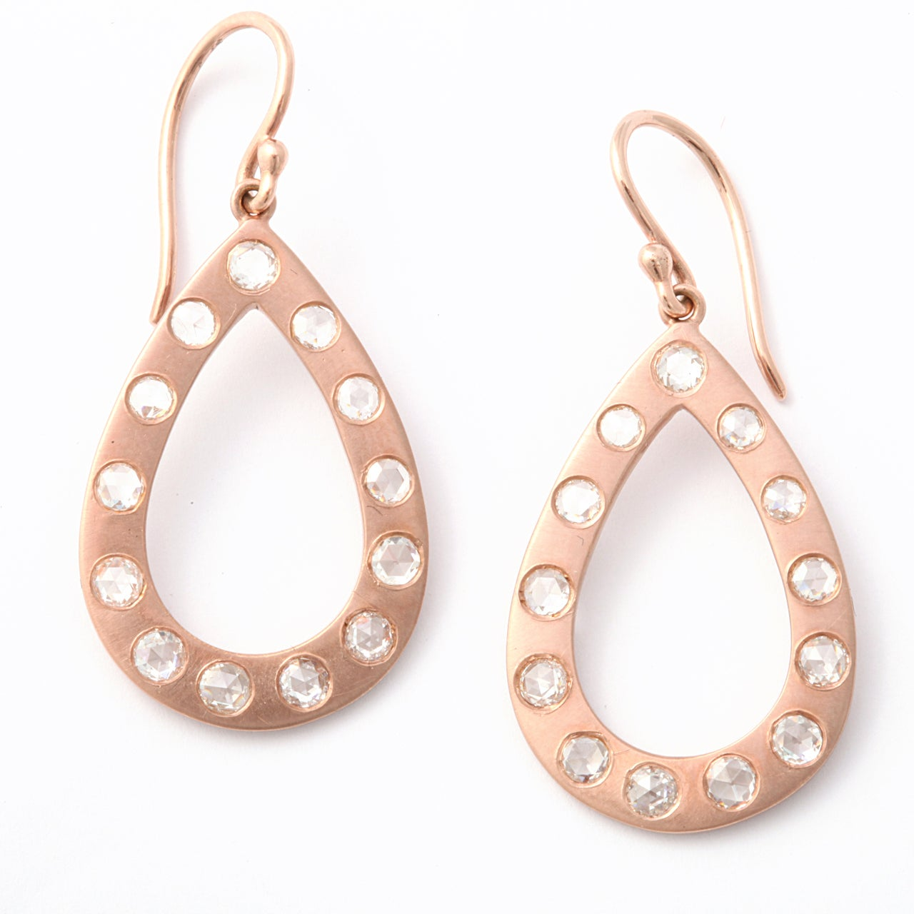 open rose gold pear shape applied with 26 rose cut diamonds approximate weight 2.80 carats