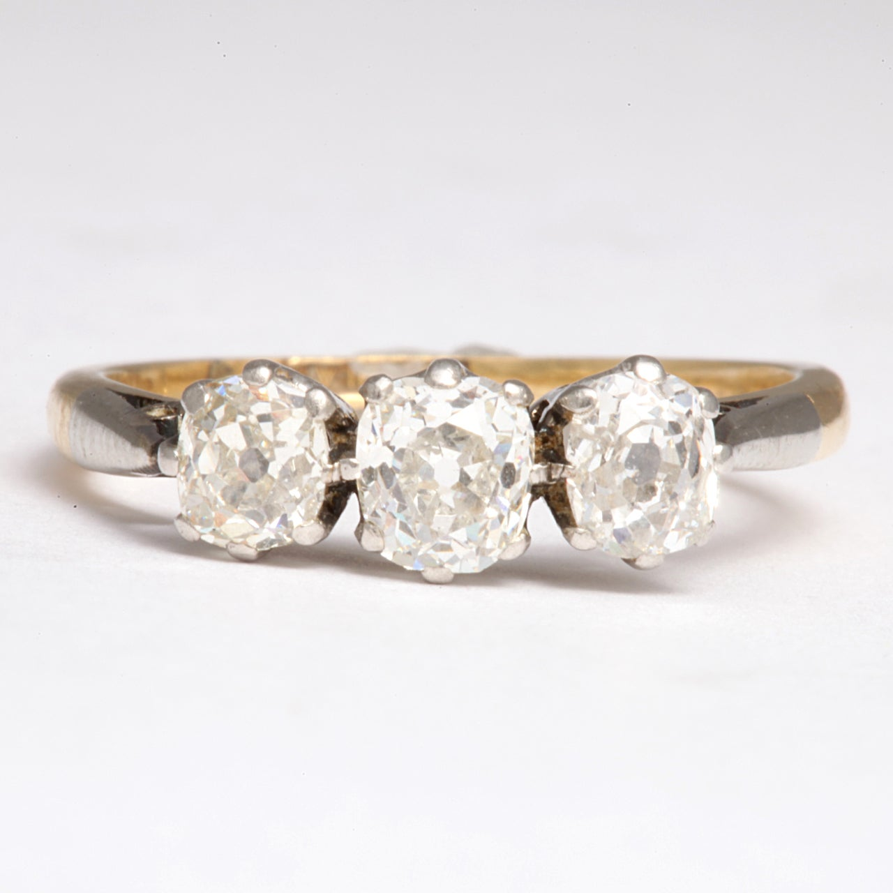 Three Old Mine Diamonds of approximately 1.30 cts, set in platinum and gold, announce your devotion then, now and forever as they radiate their beautiful light. Elegant and warm, the size of the stones,neither small or large, but feel rightly