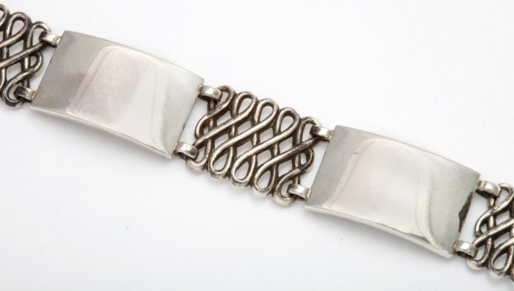 In time for Fathers' Day, here is an older design Georg Jensen bracelet made by the master in 1939.   Both men or women will wear it alone or with other silver bracelets, The links alternate, one open braided link with one solid rectangular links