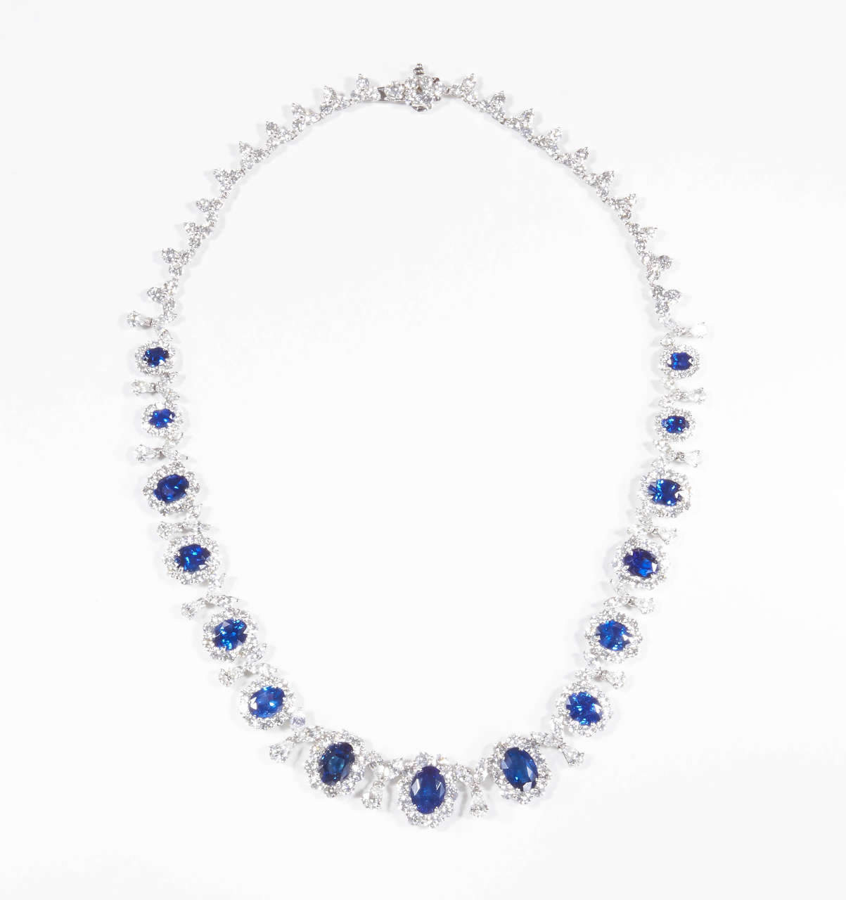 Beautiful blue oval sapphires set in a handmade 18k white gold diamond necklace.   Over 25 carats of sapphires.  Over 25 carats of white diamonds.  Please contact us for more information.