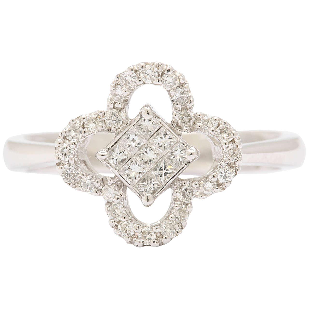 Invisibly Set Diamond Gold Ring