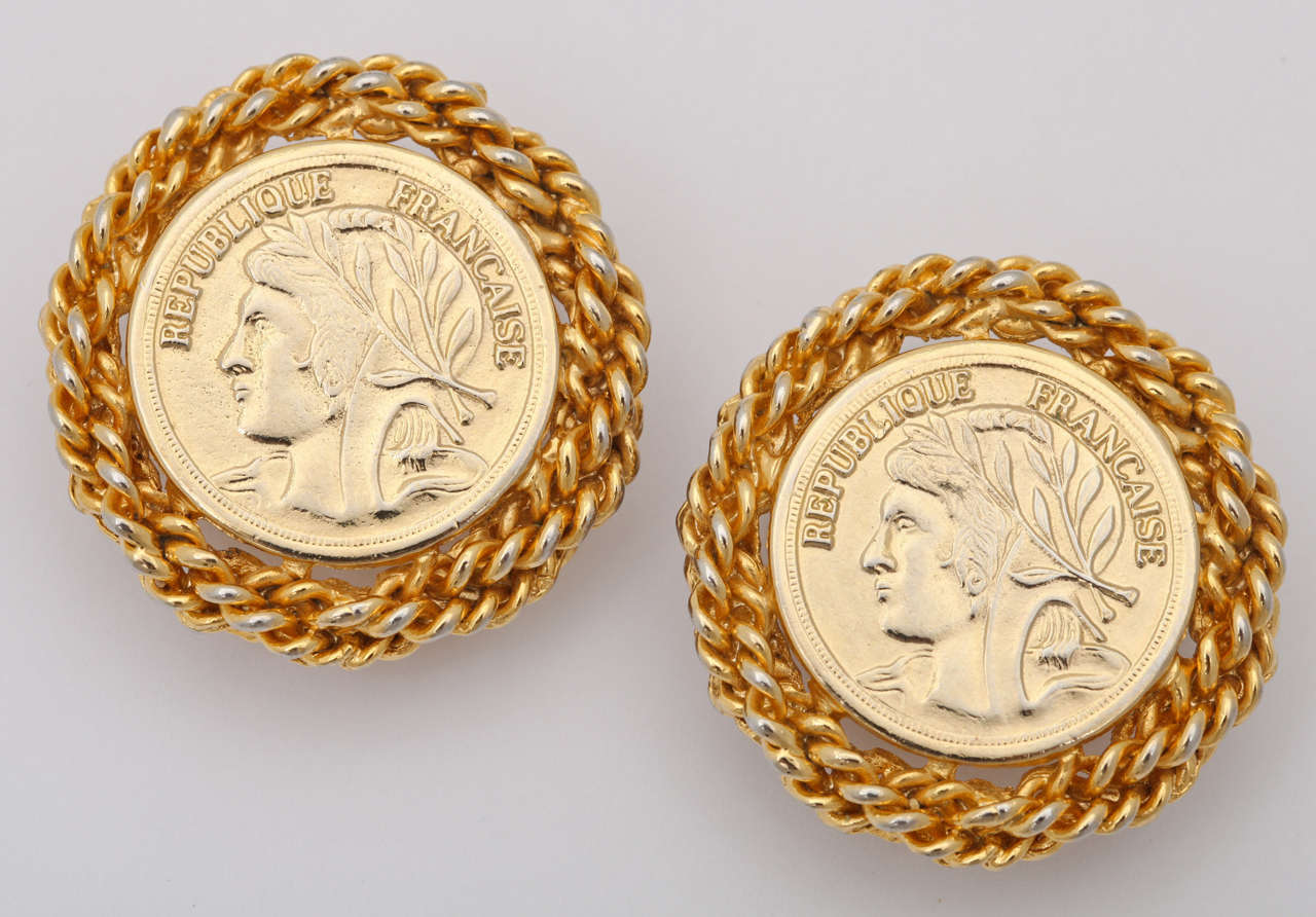 Large gold tone French coin earrings edged in chain links.
