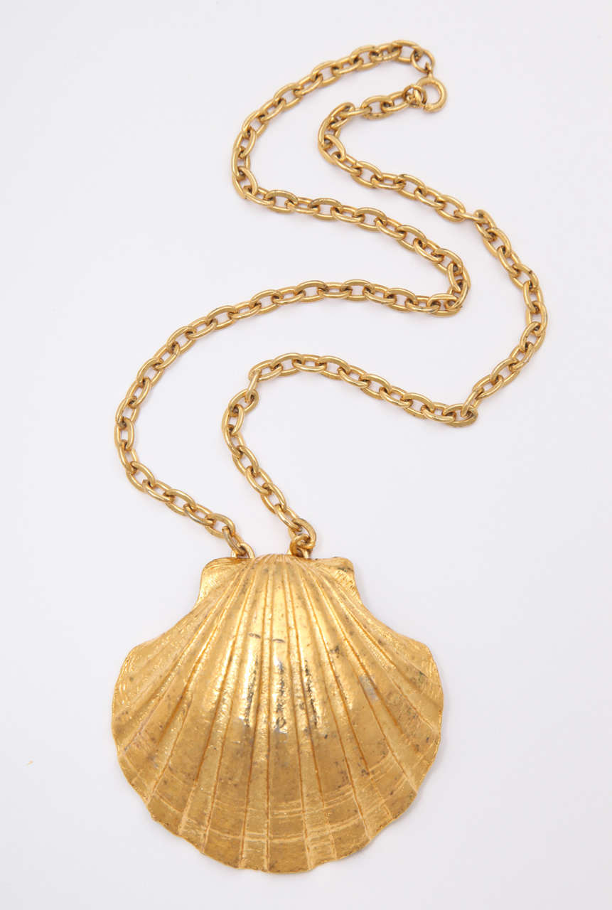"Single large shell necklace. Chain is 8.75"" long."