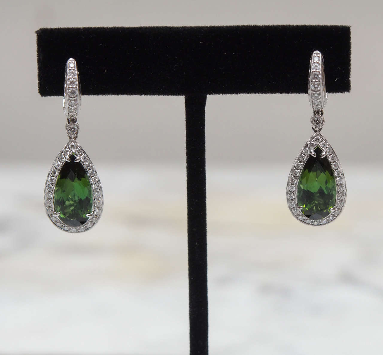 One pair of Chrome Tourmaline and diamond earrings.  The tourmalines weigh approximately 3.85cts each.  There are 34 diamonds, having F-G color and VS clarity, in each earring weighing approximately 1.02cts. Total weight for the tourmalines is