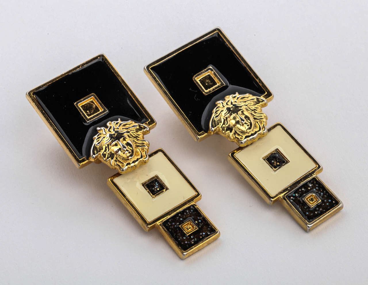 Very rare vintage Gianni Versace earrings with Medusa in black and white.