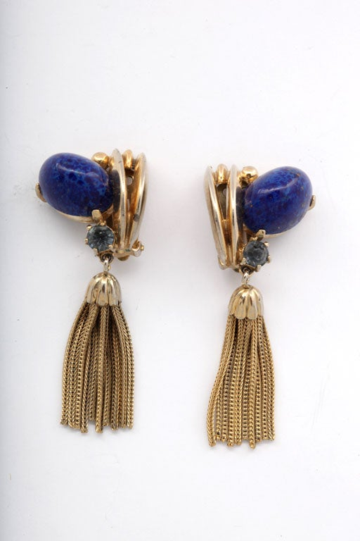 Schiaparelli goldtone tassel earrings with a lapis stone and a blue rhinestone.