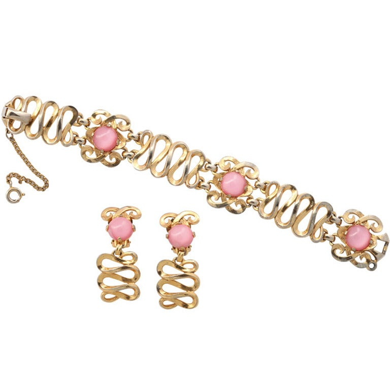 Schiaparelli Goldtone and Pink Stone Bracelet and Earrings For Sale