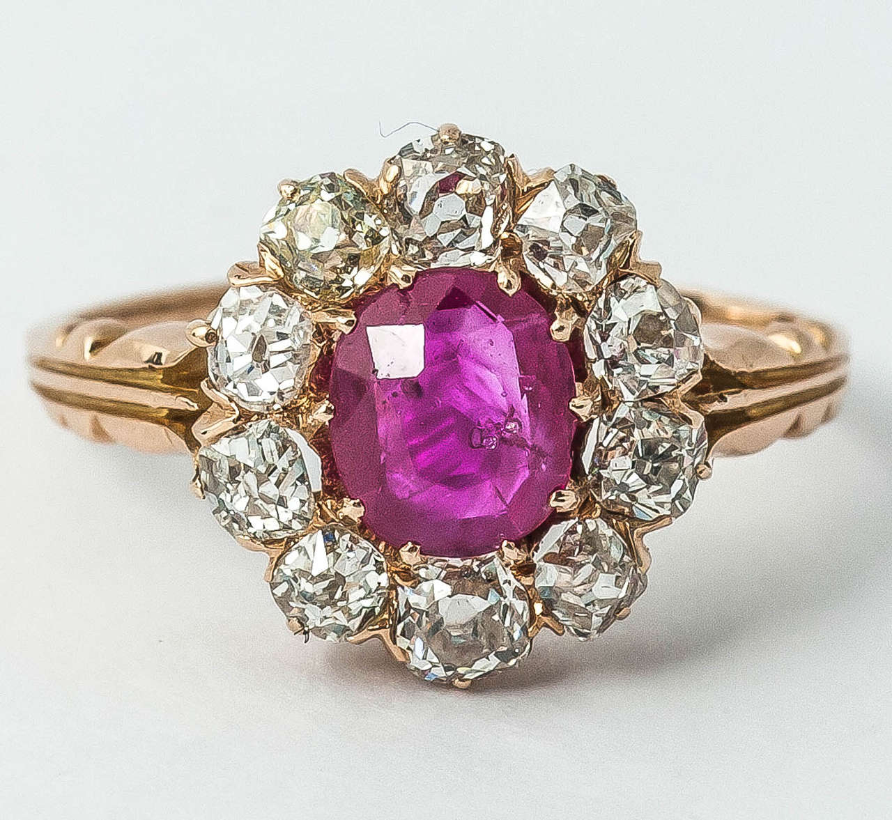Nineteenth century oval burma ruby and old cut brilliant diamond cluster ring, circa 1870.