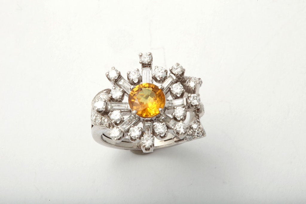 Stunning Platinum & Diamond Assymetric Ring center set with intense faceted Yellow Sapphire - approcimately 1.75cts, and set with radiating full cut Diamond brilliants & baguettes.  Stunning - whether worn as a pinky ring or on a ring finger.