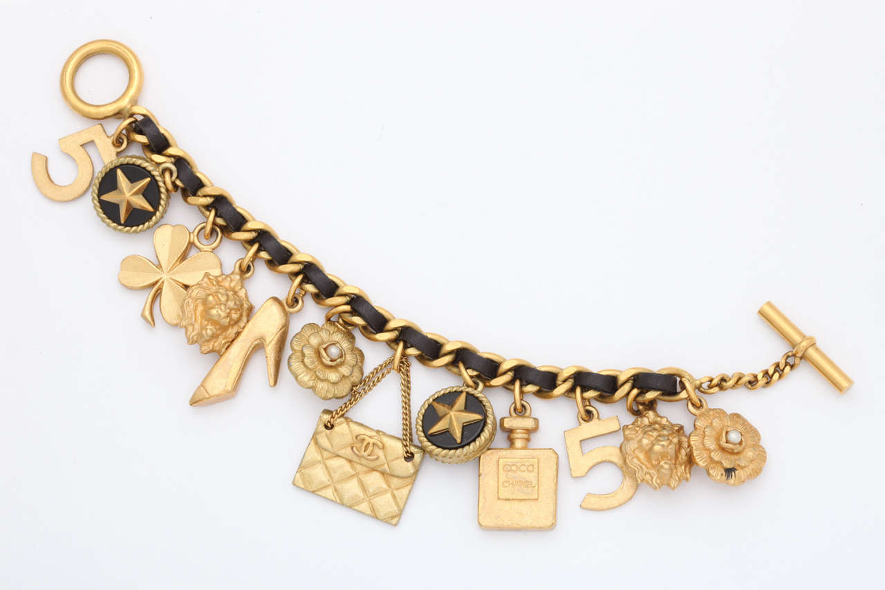 vintage chanel iconic charm bracelet with black leather