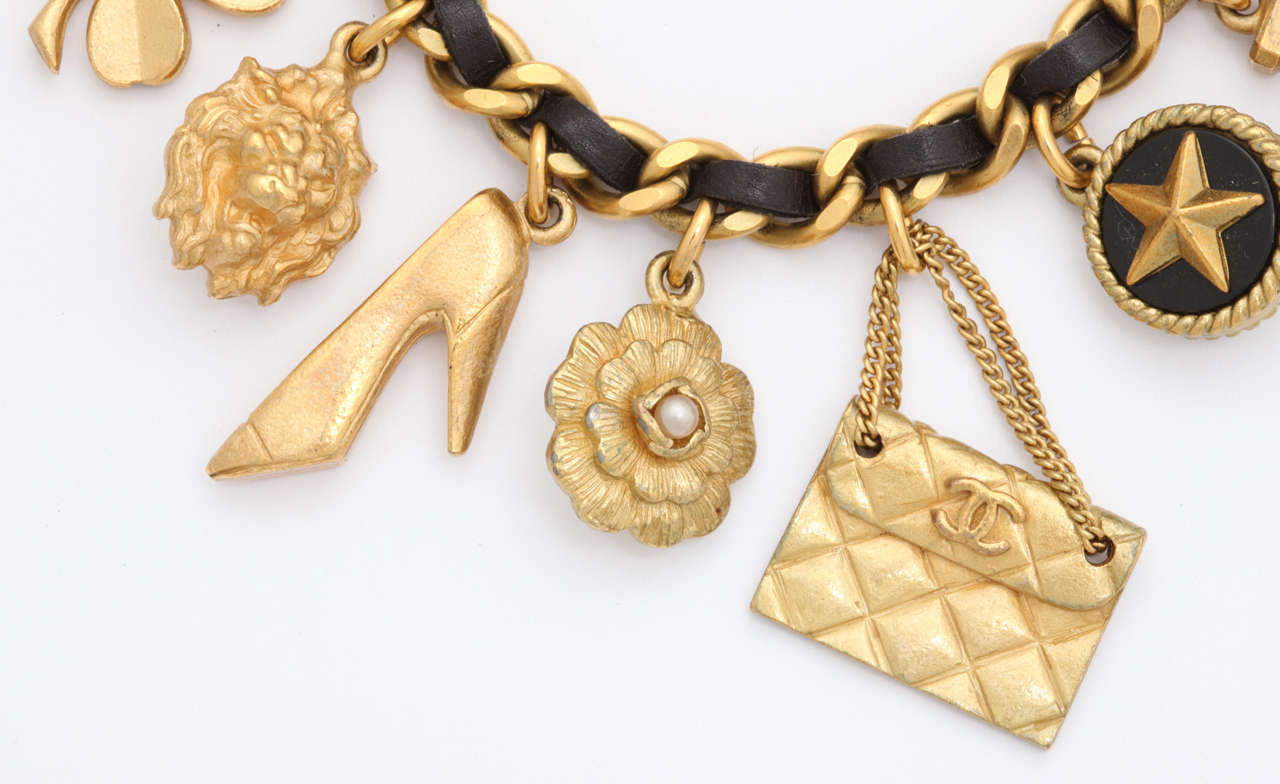 Vintage Chanel Iconic Charm Bracelet with Black Leather/Gold Chain In Fair Condition For Sale In New York, NY