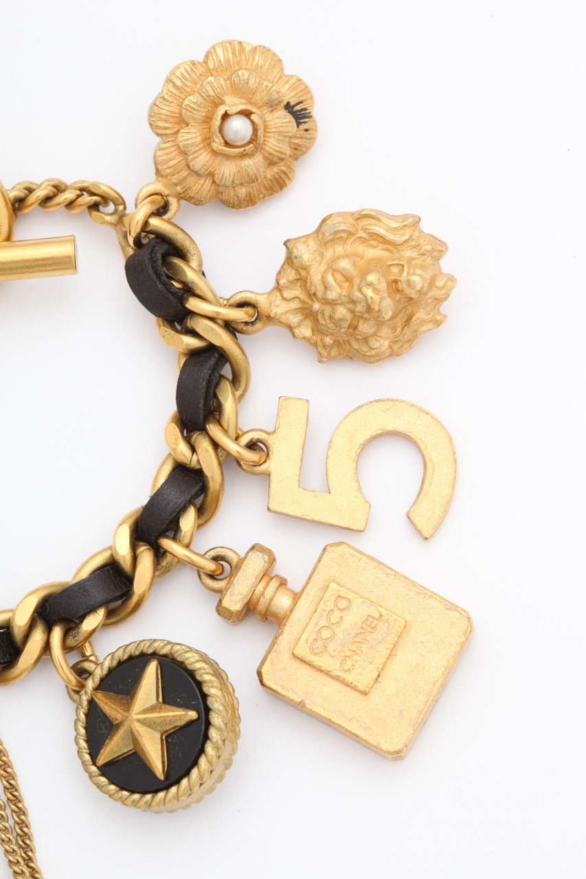 Women's Vintage Chanel Iconic Charm Bracelet with Black Leather/Gold Chain For Sale