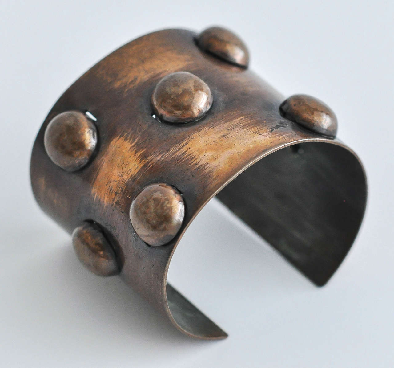 """A rare, hand-assembled copper cuff by modernist craftsman Francisco Rebajes (1907-1990). The avant-garde, abstract geometric design of this bracelet suggests the """"punk"""" and unconventional forms of later designers such as Jean Paul Gaultier and"""