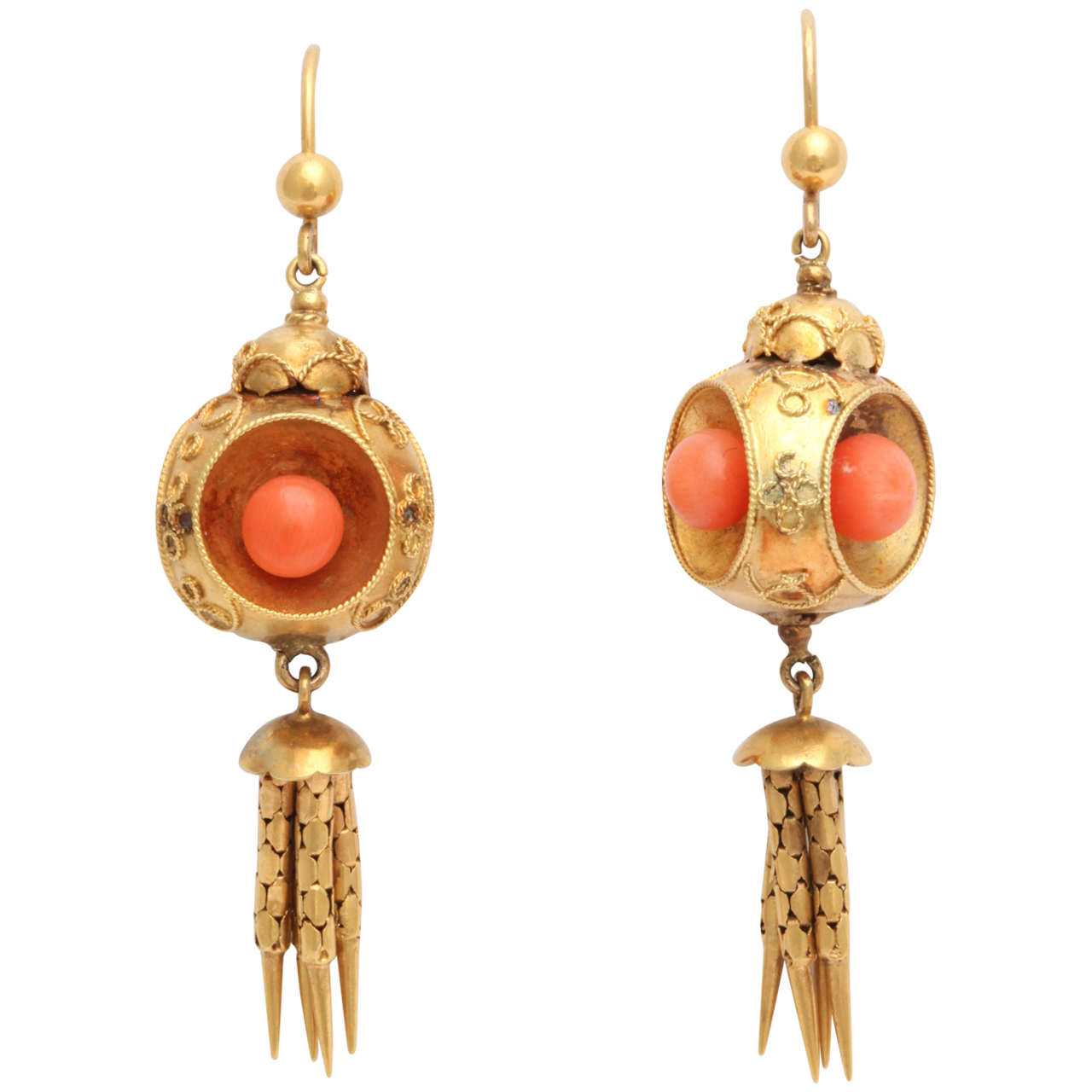 These gorgeous Victorian coral and gold earrings, circa 1870 are designed as 18k gold spheres with granulation suspending hi-karat gold tassels.  Victorian, circa 1870.  2 1/4 in. (5.7 cm) long.