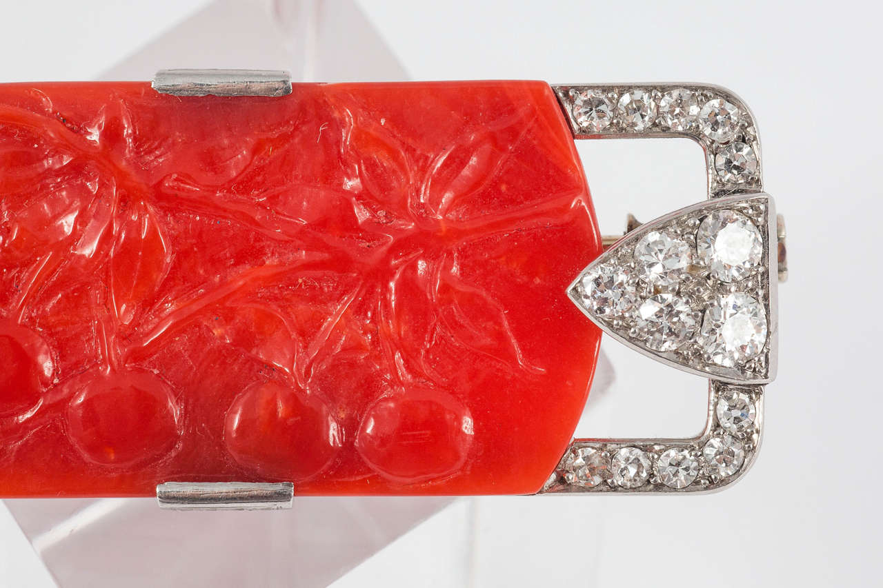 Fine carved Coral Plaque  depicting cherries set in Platinum with Diamonds. French control marks