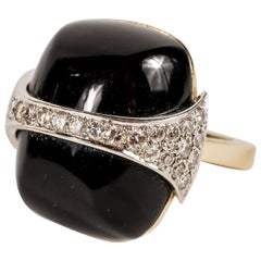 Strong and Bold 1970s La Triomphe Black Onyx Diamond Gold Ring