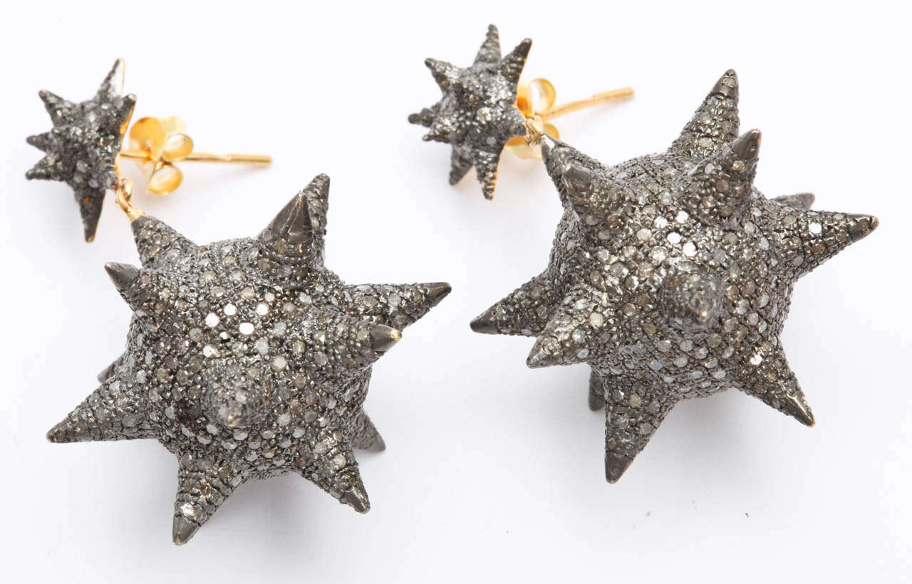 A pair of rhodium plated sterling silver and diamond star earrings. The earrings come in two sizes. The large star earrings have 9.66cts of diamonds ($7500.00) and the small star earrings have 3.60cts of diamonds ($6000.00). Height (L) 1.80