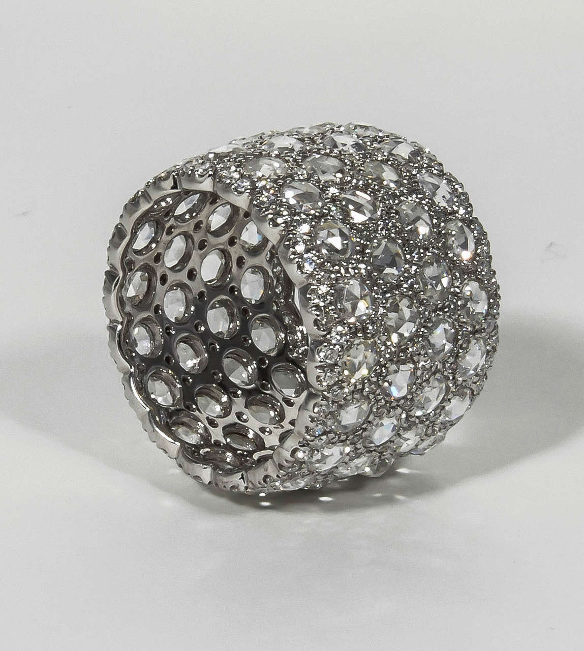 6.32 carats of white rose and full cut diamonds set in 18k white gold.  Just over 15 mm wide.