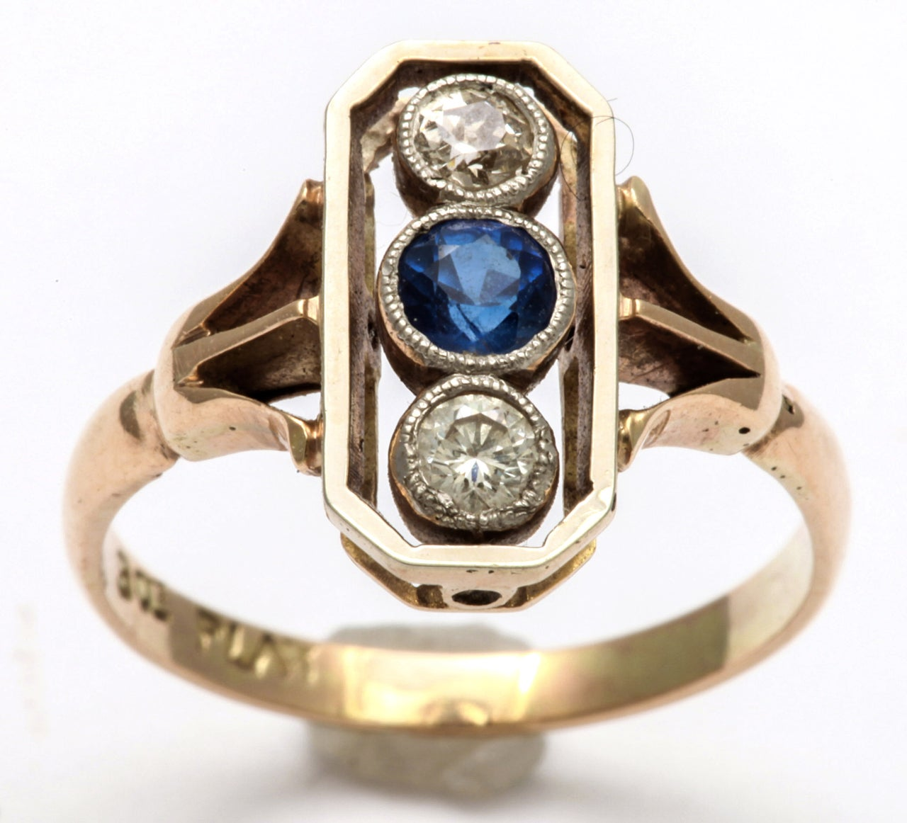 A ring for a child or  the pinky that is small, I thought, as It fit my little finger, but it was enduringly lovely and has entranced me by its sweet character for the last week. With its 5 pt. old mine diamonds and 10pt admiral blue sapphire, the