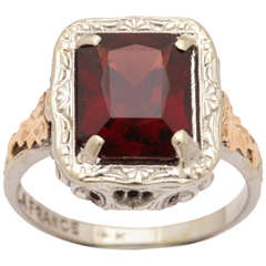 Passion Sparkles in a Garnet and Gold Ring
