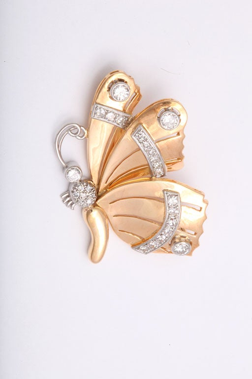 Beautifully designed butterfly brooch graces any outfit.  The diamonds are set in platinum and the main body of the brooch in 18k pink gold.