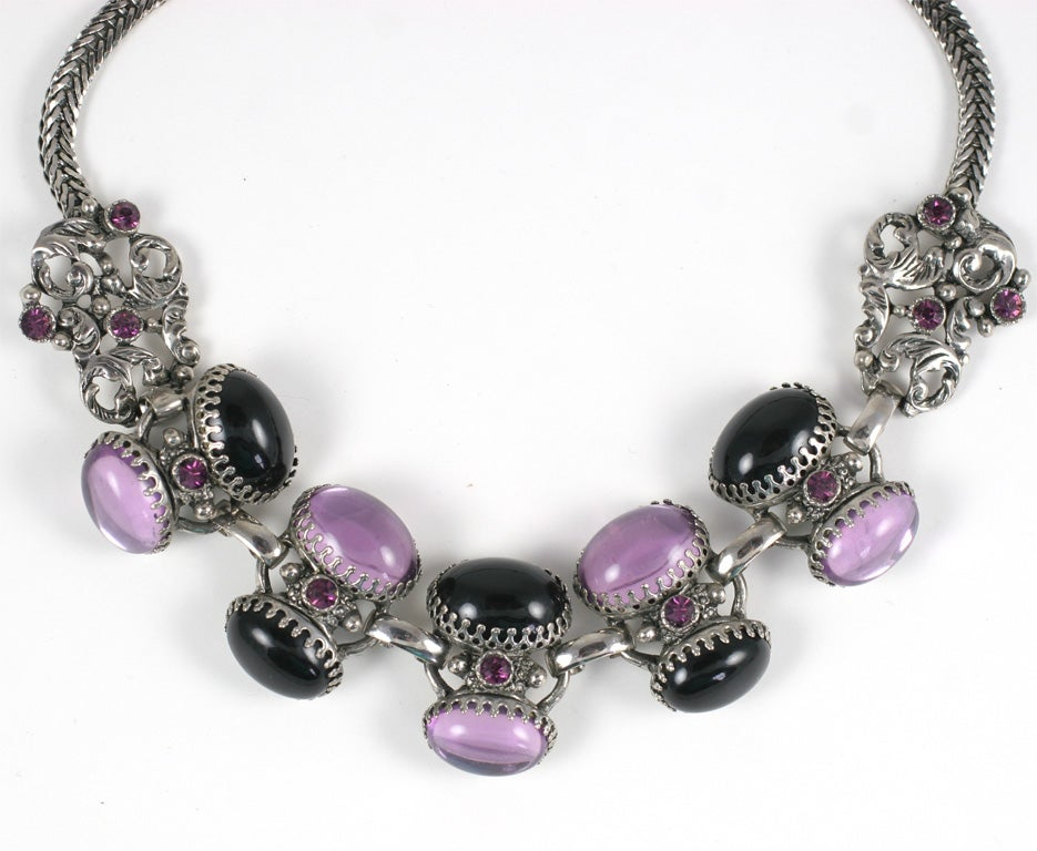 Dramatic amethyst and jet style, prong set  oval cabochon necklace and earrings in silvertone metal. Earrings are 1 inch by 1.5 inches.