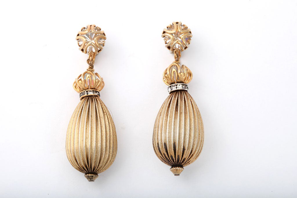 Goldtone metal and rhinestone teardrop shaped earrings.