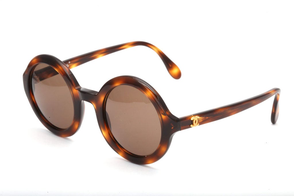 Very rare Chanel round sunglasses in brown and gold.