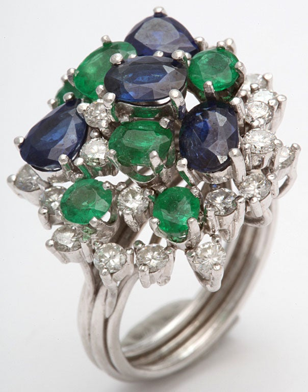 Handmade Platinum Mounting prong set with 4 Oval Sapphires, 6 various shaped Emeralds &  25 full cut & very white Diamonds. Size 5 1/2+. Engraved Plat. Possibly Oscar Heymann.