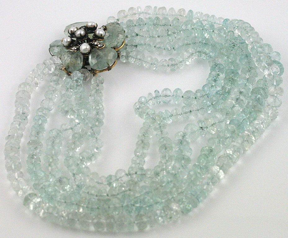 A stunning five strand necklace of faceted aquamarine beads by Iradj Moini with a gorgeous 2.25