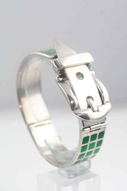 A chic sterling silver buckled bracelet inset with green enamel. Stamped